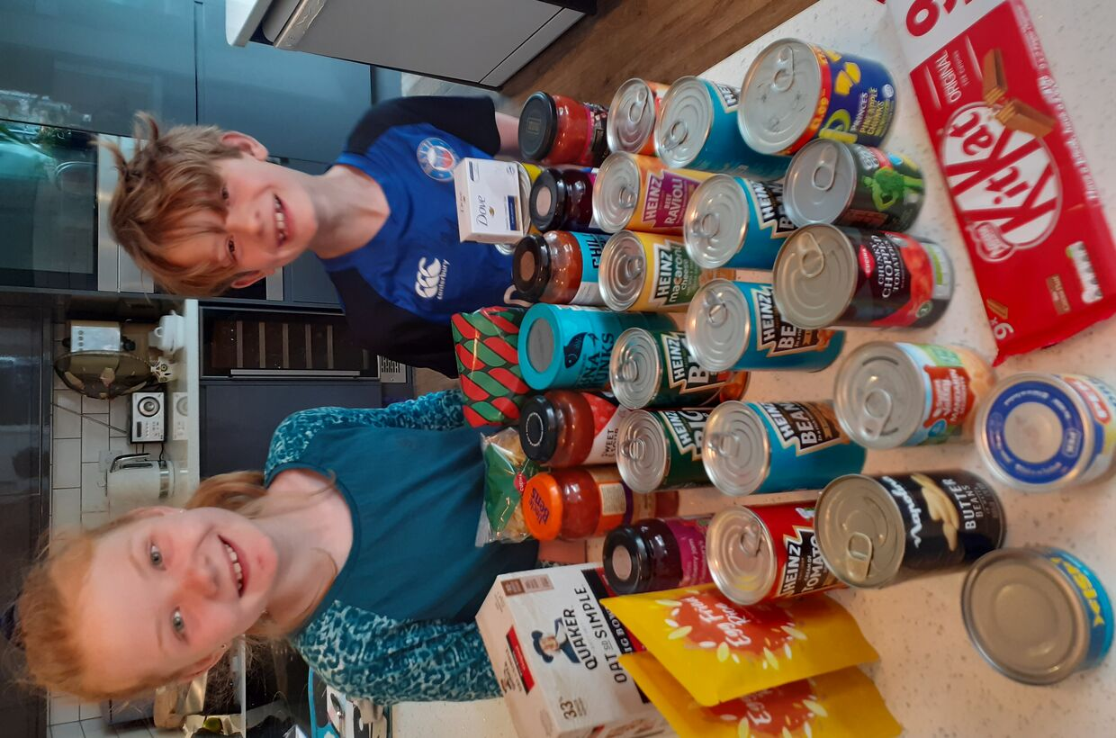 Pupils organise cake and juice stall to raise money to buy items for Melksham Foodbank